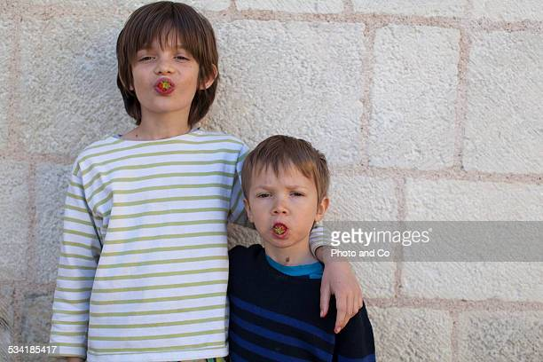 boys eating strawberries