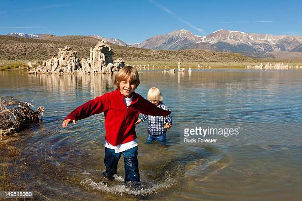 boys enjoying in lake - wet jeans stock photos and pictures