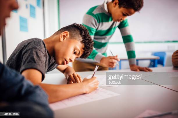 Boys Enjoying School Work Together
