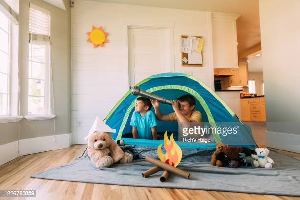 boys exploring with telescope indoors - day stock pictures, royalty-free photos & images