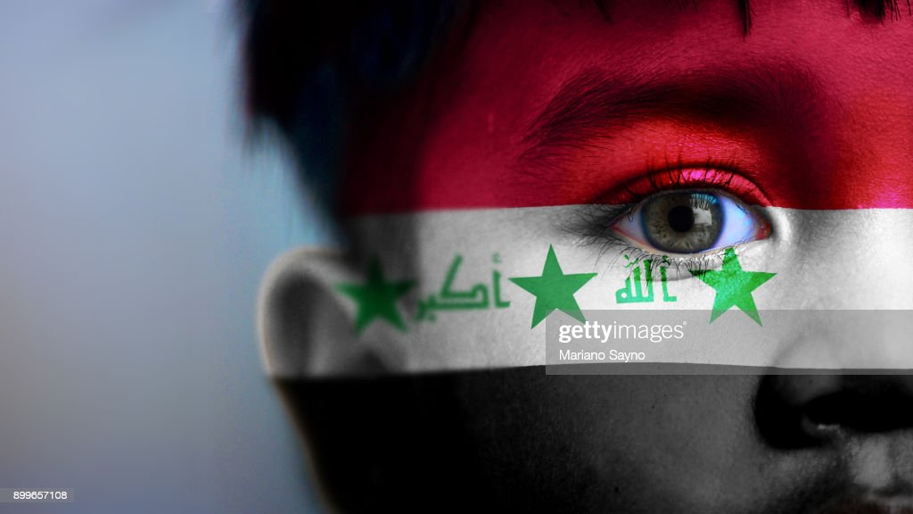 Boy's face, looking at camera, cropped view with digitally placed Iraq flag on his face. : Stock Photo