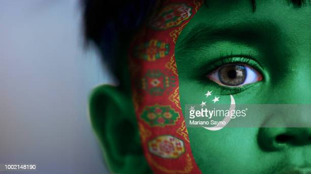 Boy's face with digitally placed Turkmenistan flag on his face.