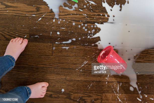 boy's feet by spilt milkshake - spilling stock pictures, royalty-free photos & images