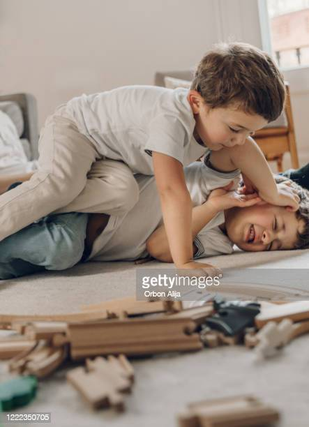 boys fighting while in quarantine fro covid-19 - genderblend stock pictures, royalty-free photos & images