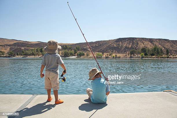 boys fishing by lake - castaic lake stock pictures, royalty-free photos & images