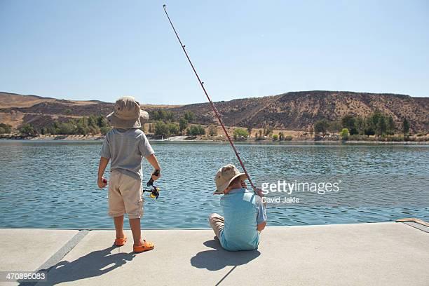 Boys fishing by lake