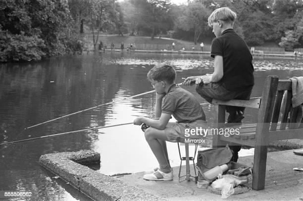 Boys fishing in Battersea Park 7th August 1963