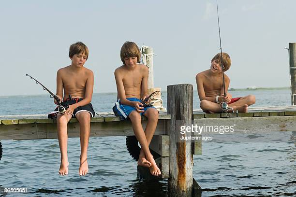 Boys fishing on pier