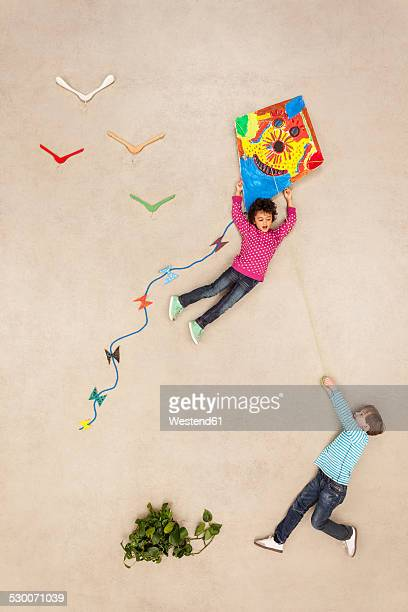 boys flying kite - kite toy stock photos and pictures