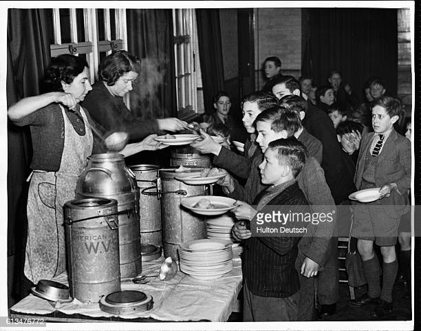Boys from Epsom Central School are served with their school dinner Surrey Council has more than doubled the number of children receiving hot school...
