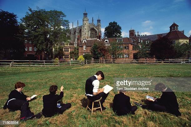 Boys from Eton public school drawing St George's Chapel from a nearby field.