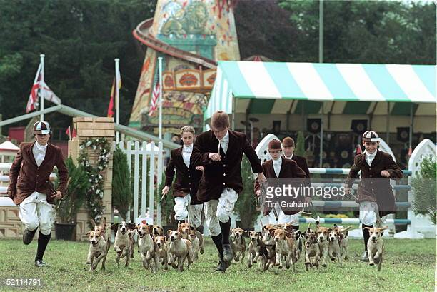 Boys From Eton School Compete At The Royal Windsor Horse Show Showing Off Their Pack Of Foxhounds