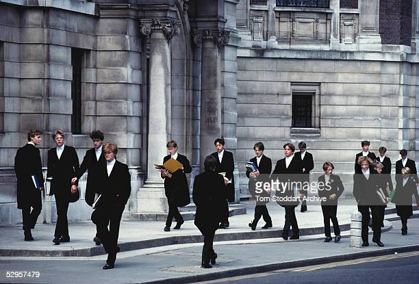Boys from Eton School pass each other in the streets outside the college during the change over of lessons