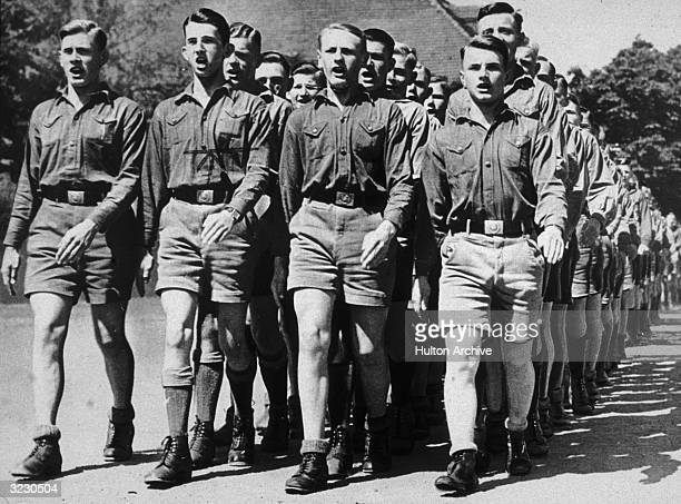 Boys from one of Hitler's Nazi youth camps marching in formation, Germany.