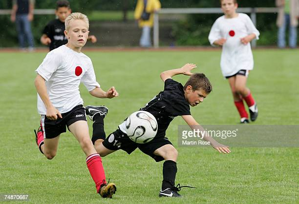 Boys from the 911 year old age group battle for the ball during the German Football Association's EYouth children's soccer tournament on June 23 2007...