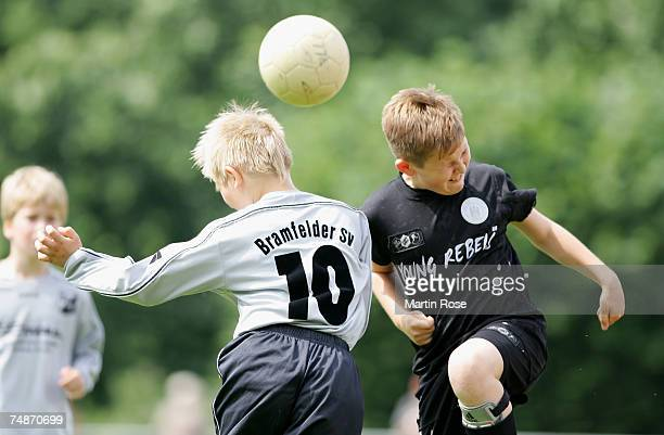 Boys from the 9-11 year old age group go up for a header during the German Football Association's E-Youth children's soccer tournament on June 23,...