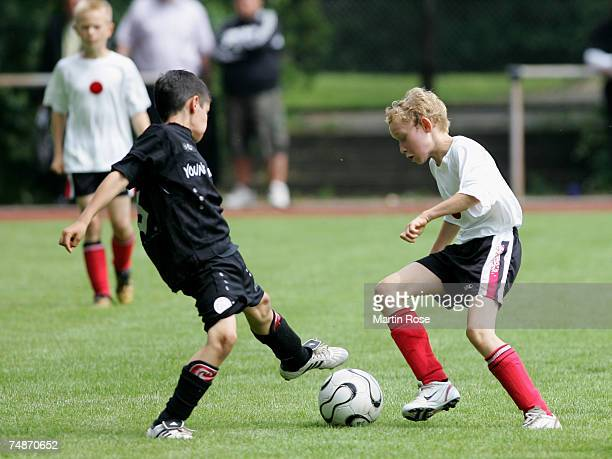 Boys from the 911 year old age group in action during the German Football Association's EYouth children's soccer tournament on June 23 2007 in...