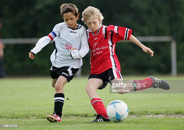 Boys from the 9-11 year old age group in action during the German Football Association's E-Youth children's soccer tournament on June 23, 2007 in...