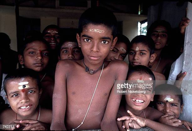 Boys from the Brahmin caste crowd around for a photo October 1991 in India. Of the five castes of Hinduism, Brahmins occupy the highest level and are...