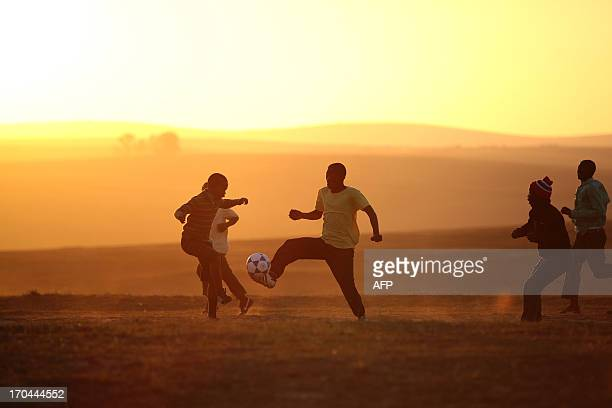 Boys from the Eastern Cape village of Qunu play soccer on a makeshift pitch on June 13 2013 Qunu was home to former South African president Nelson...