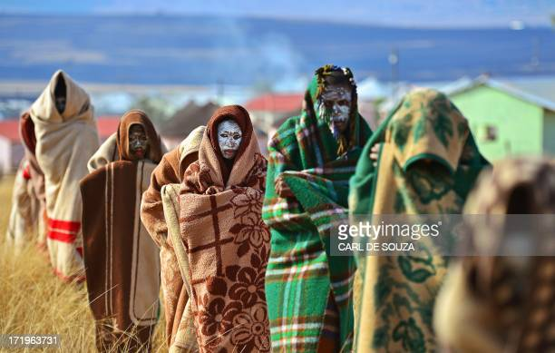 Boys from the Xhosa tribe who have undergone a circumcision ceremony are pictured near Qunu on June 28, 2013. Qunu is where former South African...