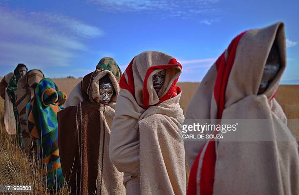 Boys from the Xhosa tribe who have undergone a circumcision ceremony sit near Qunu on June 30 2013 Qunu is where former South African President...
