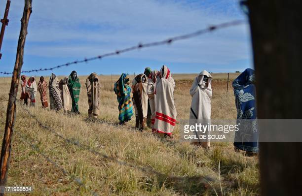 Boys from the Xhosa tribe who have undergone a circumcision ceremony walk near Qunu on June 30, 2013. Qunu is where former South African President...