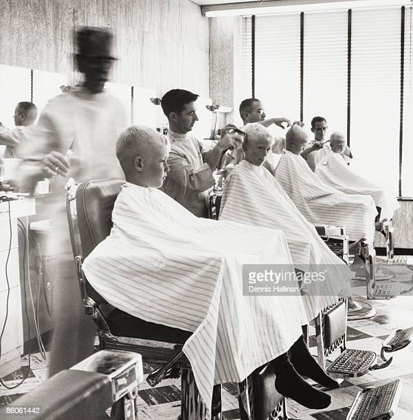 Boys getting haircuts at barbershop