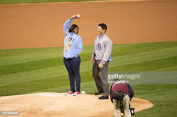 Boys Girls Clubs of Greater St Louis Herbert Hoover Club Amanda Richardson delivers the first ball to the mound with former St Louis Cardinals player...