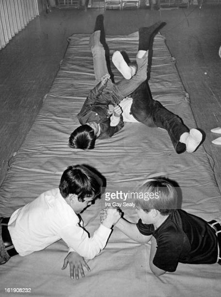 MAR 23 1971 MAR 24 1971 Boys Give Preview of Gymnastics Program Indian wrestling are Tom Matre and Greg Newman In formation at back are Alex Miller...