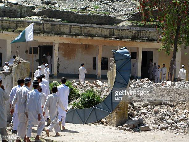 Boys go to class in a school where the buildings were destroyed in a bombing by the Taliban Schools with even worse damage from Taliban bombing are...
