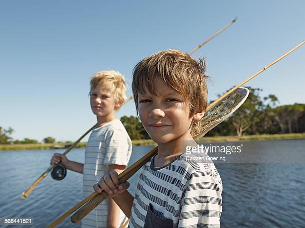 2 boys going fishing at a lake