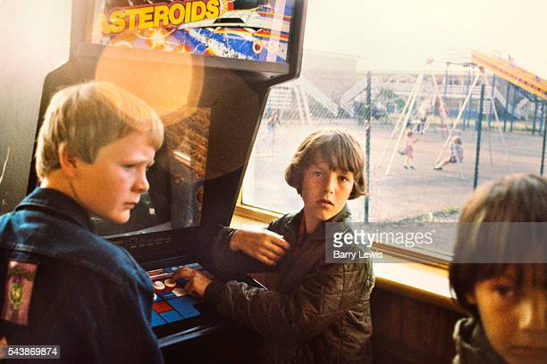 Boys hanging around in the amusements arcade Butlins Holiday camp Skegness Butlins Skegness is a holiday camp located in Ingoldmells near Skegness in...