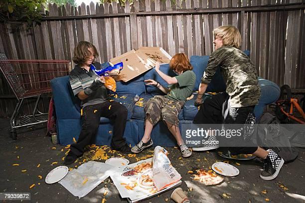 Boys having a food fight