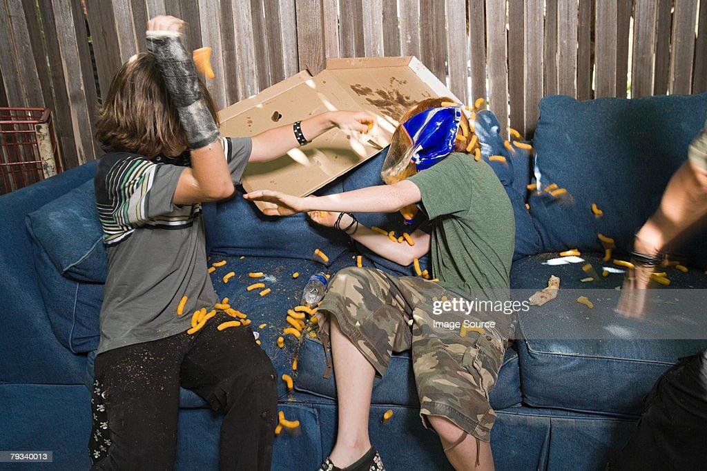 Boys having a food fight : Stock Photo
