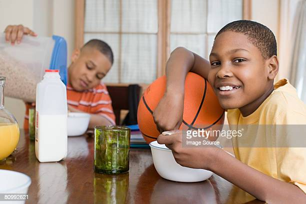 boys having breakfast - milk carton stock photos and pictures