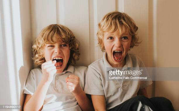 boys having fun - shouting stock pictures, royalty-free photos & images