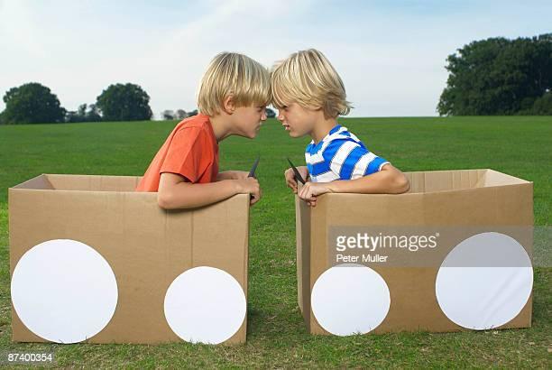 boys head to head - diverbio foto e immagini stock