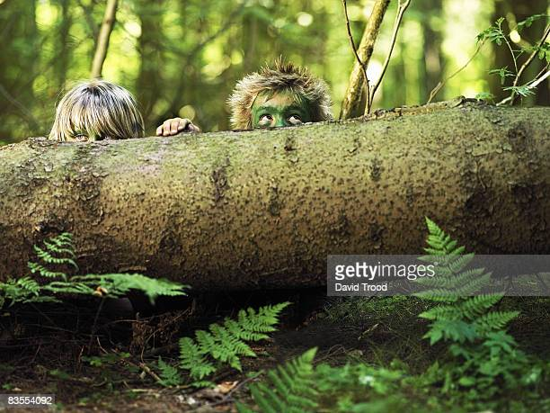 Boys hiding in the forest.
