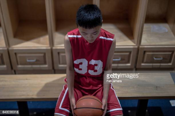 boys high school basketball team: - defeat stock photos and pictures