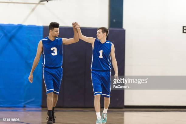 boys high school basketball team: - warm up exercise stock pictures, royalty-free photos & images