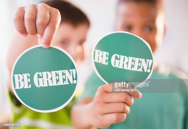 Boys holding Be Green signs