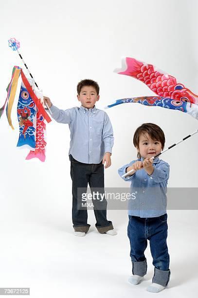 boys holding flags of carp - 鯉のぼり ストックフォトと画像