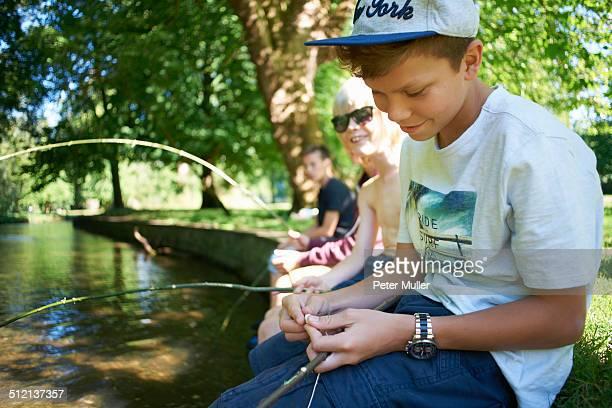 Boys holding sticks, fishing