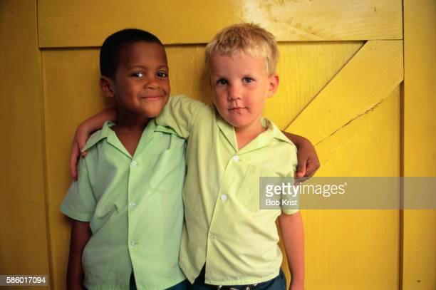 boys hugging each other - シント・ユースタティウス島 ストックフォトと画像