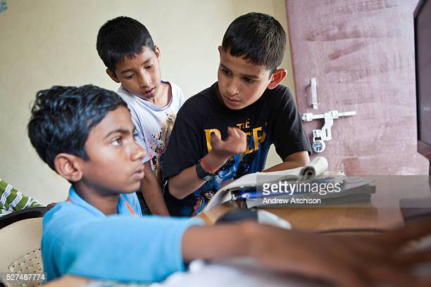 Boys in a computer lesson at the Pragya Alternate Learning Hub Joshimath Uttarakhand Central Himalayas India The school is organised and funded by...