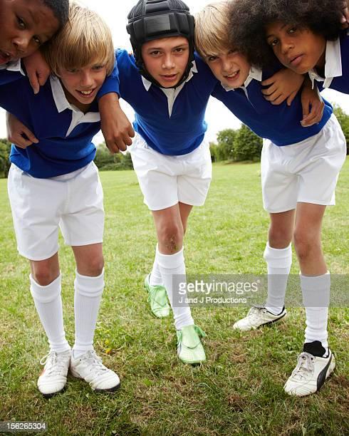 Boys in a rugby scrum
