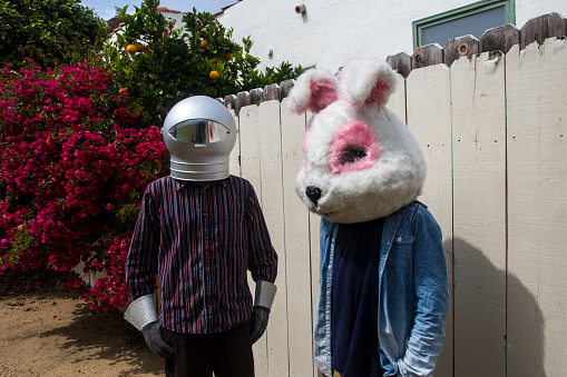 Boys in Backyard Wearing Space Helmut and Bunny Mask - gettyimageskorea