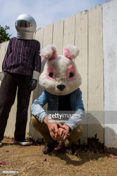 boys in backyard wearing space helmut and bunny mask - rabbit mask stock pictures, royalty-free photos & images