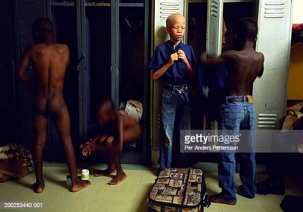 boys in blind school dress early in the morning in klipriver, so - young boys changing in locker room stock pictures, royalty-free photos & images